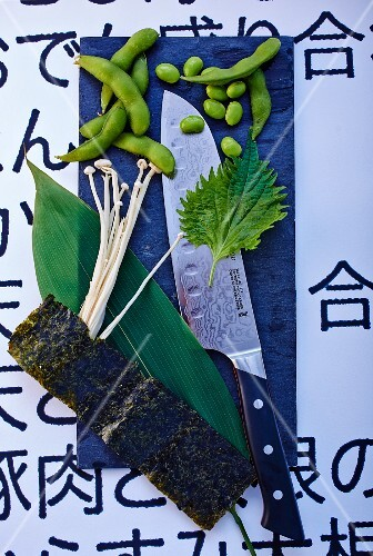 Vegetables, mushrooms, herbs and a knife from Japan