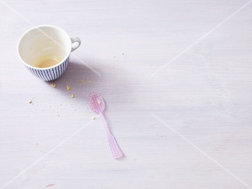 An empty coffee cup with a spoon