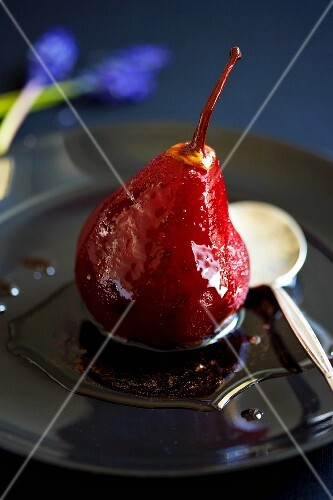 A poached pear in red wine