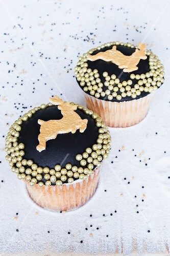 Vanilla and whiskey flavoured cupcakes decorated with reindeer