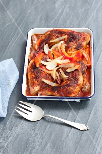 Roast chicken legs with peppers and onions