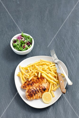 Grilled Barbecued Chicken with French Fries