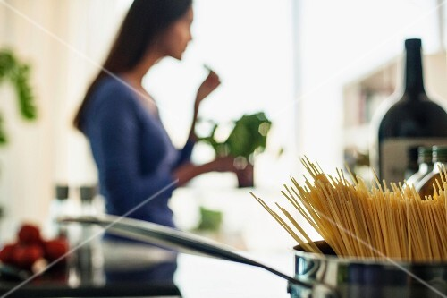 A unfocused image of a young woman cooking