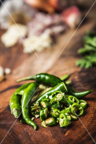 Green chilli peppers, partially sliced