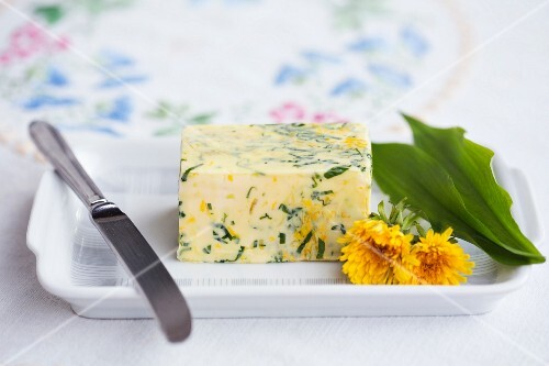 Herb butter with dandelion flowers and wild garlic
