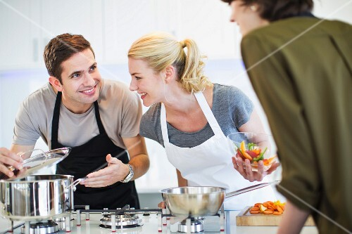 Friends cooking together in a kitchen