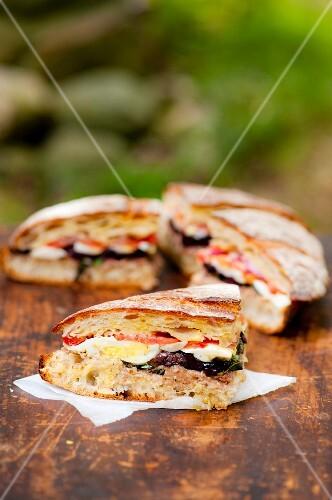 Pan bagnat (olive, egg, tomato and tuna sandwich, France)