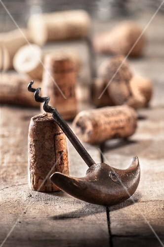 An old corkscrew and wine corks