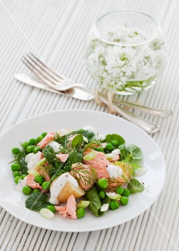A salad of salmon, new potatoes, peas, fresh mint and dill with a yoghurt dressing