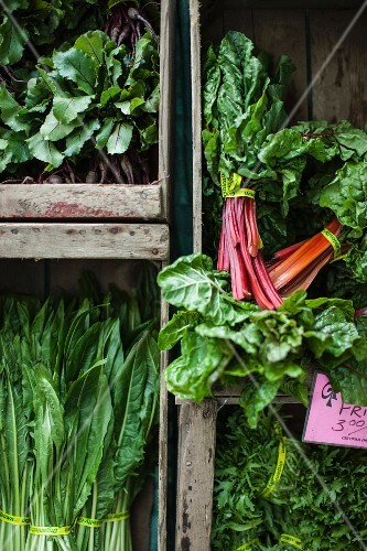 Chard and lettuce in crates at a market