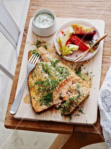 Salmon grilled on cedar wood with a dill sauce