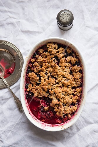 Mixed Berry Crumble in Baking Dish with Spoon