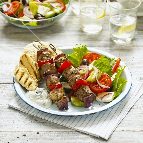 Lamb skewers with Greek salad