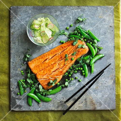 Salmon teriyaki with peas and cucumber salad