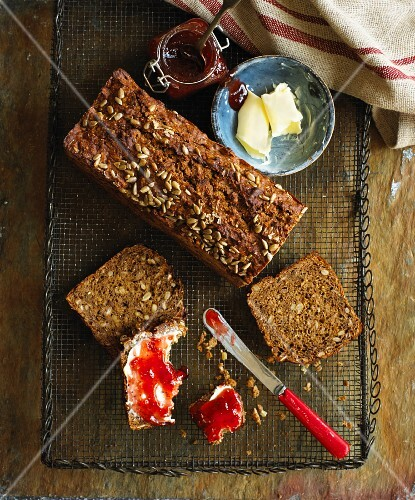 Walnut bread with butter and jam (seen from above)