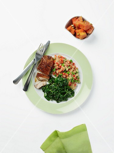 Pork loin with quinoa pilau and garlic spinach served with papaya salad (diabetic meal)