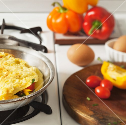 An omelette in a pan with various ingredients
