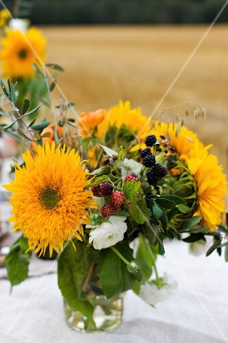 Bouquet of late-summer flowers and blackberries
