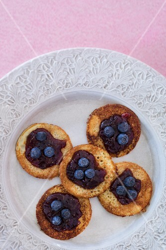 Mini pancakes with blueberries and blueberry jam