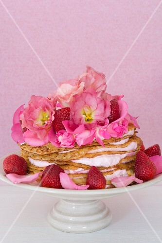 A pancake cake with strawberries and mascarpone
