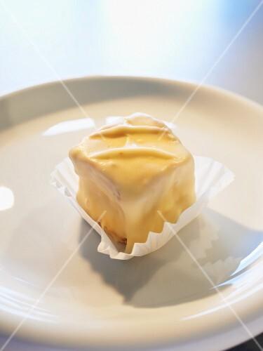 A blondie, mini cake with white chocolate glaze