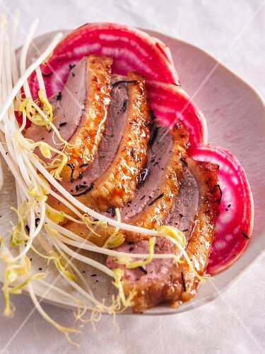 Duck breast with tea on beetroot