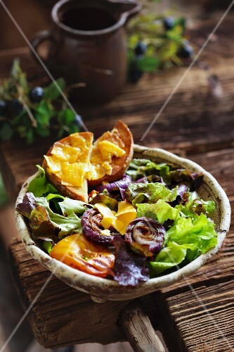 Mixed leaf salad with grilled vegetables in a rustic bowl