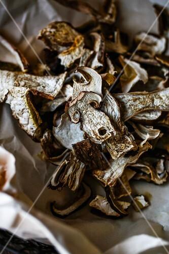 Dried porcini mushrooms on crumpled paper