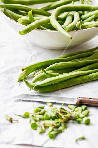Green beans being trimmed and chopped