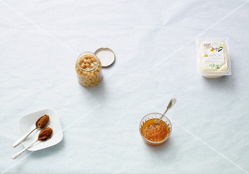 Ingredients for vegan cuisine: chickpeas, curry, tofu and chutney