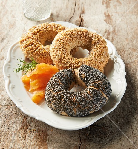 Three different bagels with smoked salmon and dill