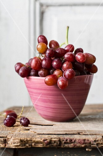 Red grapes in a pink bowl