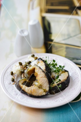 Sturgeon steaks with capers