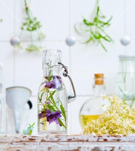Lavender vinegar and elderflower vinegar with a caterpillar toy