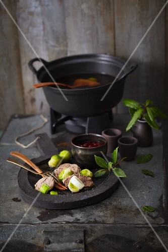 Fondue with game, Brussels sprouts, leek and a cranberry dip