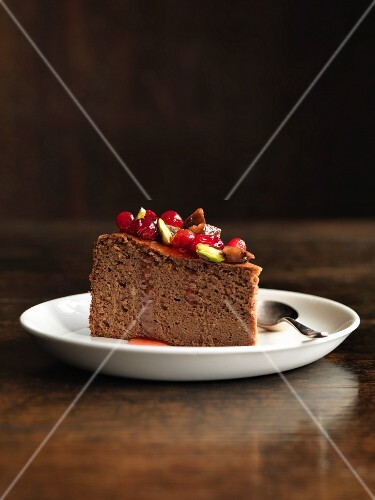 A slice of chocolate and chestnut cake with cranberry confit