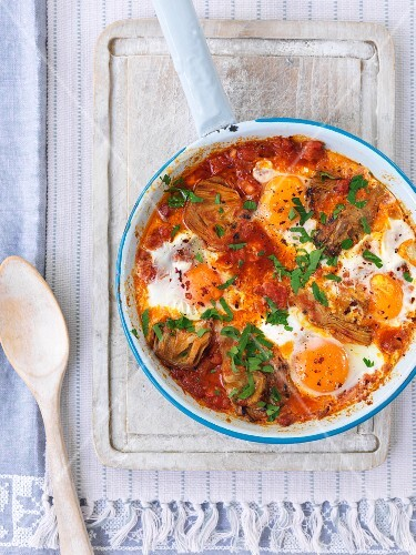 Poached eggs in a tomato and vegetable sauce