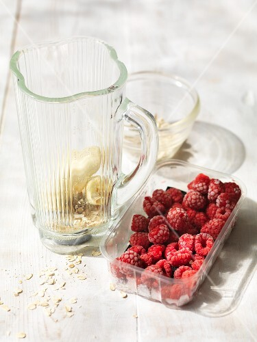 Ingredients for a raspberry and banana smoothie