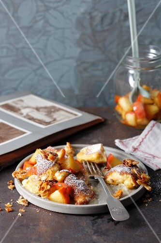 Kaiserschmarren (shredded sugared pancake from Austria) with apples and caramelised almonds