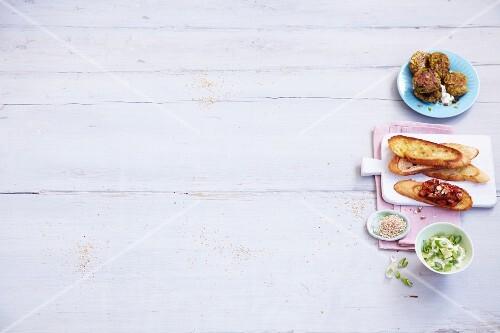 A mini buffet featuring lentil and leak cakes and aubergine crostini