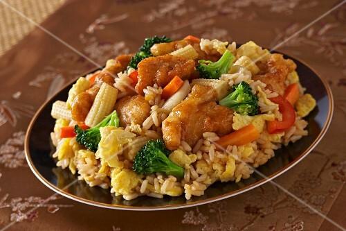 Chicken Stir Fry Over Rice in a Green Bowl; Chopsticks