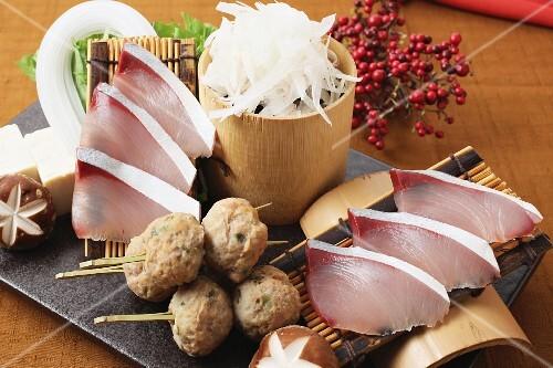 Yellowtail sashimi, dumplings and radish (Japan)