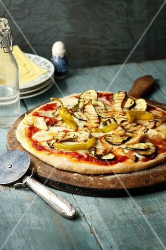 A vegetarian pizza with courgettes, aubergines and chilli peppers
