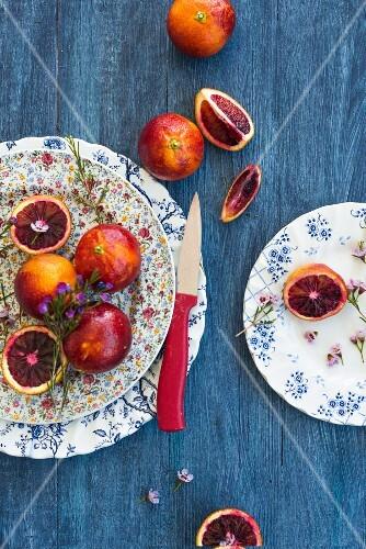 Blood oranges on decorative plates