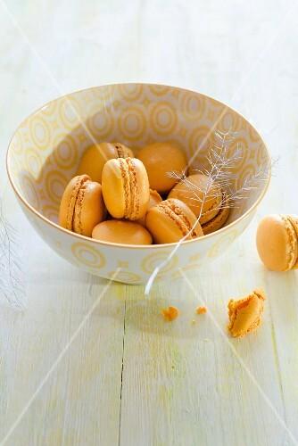 A bowl of orange macaroons