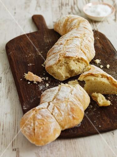 Light, vegan root bread on a wooden board