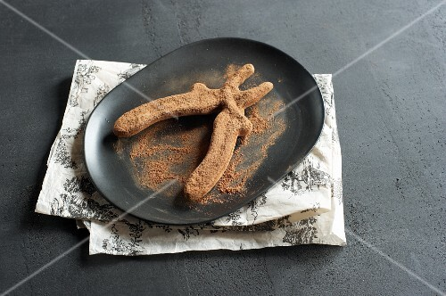 Chocolate pliers dusted with cocoa powder