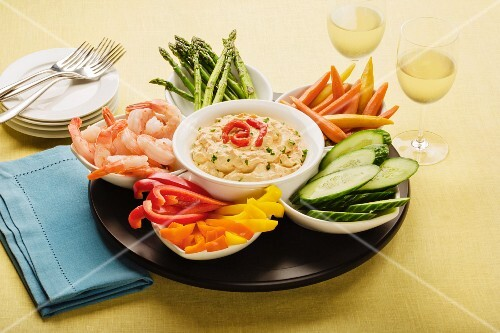 Pepper dip with prawns and raw vegetables in bowls