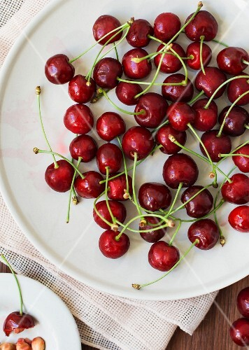 Sweet cherries on a white plate
