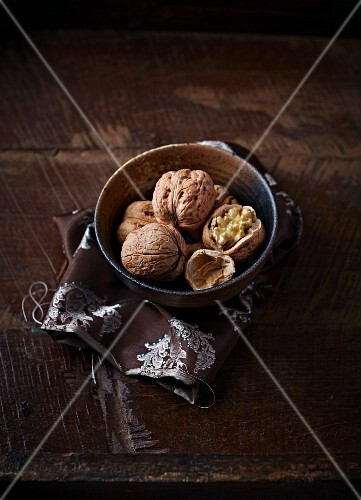 Fresh walnuts in a ceramic dish
